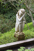Traditional stone sculpture in garden . Island Bali, Ubud, Indonesia — Stock Photo