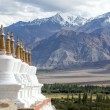 Buddhist chortens (stupa) and Himalayas mountains in the background near Shey Palace in Ladakh, India  — Stock Photo #71062313