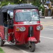 Auto rickshaw or tuk-tuk on the street of Matara. Most tuk-tuks in Sri Lanka are a slightly modified Indian Bajaj model, imported from India. — Stock Photo #71132705