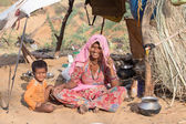 Indian woman and child at the attended the annual Pushkar Camel Mela. This fair is the largest camel trading fair in the world. — Stock Photo