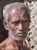 Sri Lankan beggar waits for alms on a street — Stock Photo