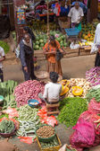 Sellers in street market sell fresh fruits and vegetables. Many people buy fresh food on the street rather than at shops. — Stock Photo