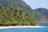 Tropical beach with exotic palm trees on the sand.Thailand — Stock Photo