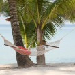 Hammock on a beautiful tropical beach — Stock Photo #71162337