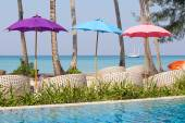 Swimming pool and beach chairs near the sea, Thailand — Stock Photo