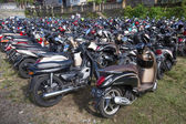 Motorbike parking on the street. Ubud, Indonesia — Stock Photo