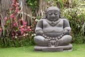 Traditional stone sculpture in garden . Island Bali, Ubud, Indonesia — Stock Photo