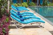 Relaxing beach chairs and swimming pool — Stock Photo
