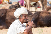 Indian man attended the annual Pushkar Camel Mela. This fair is the largest camel trading fair in the world. — Stock Photo