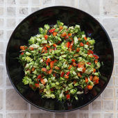Fresh salad with broccoli, red pepper, fennel, raisins, sunflower seeds — Stock Photo