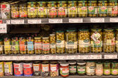 Selection canned foods in a supermarket Siam Paragon in Bangkok, Thailand. — Stock Photo