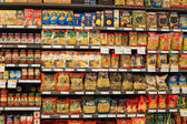 Selection of italian pasta on the shelves in a supermarket Siam Paragon, Bangkok. Siam Paragon is a one of the biggest shopping centres in Asia. — Stock Photo