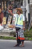 Balinese parking attendant on the main street of Ubud — Stock Photo