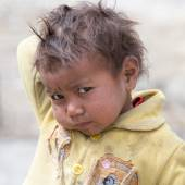 Portrait poor young boy in India — Stock Photo