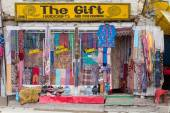 Front view of Tibetan shop clothes and souvenirs in Leh, Ladakh, India — Stock Photo