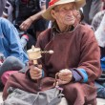 Tibetan Buddhist old men in Hemis monastery. Ladakh, North India — Stock Photo #77803302