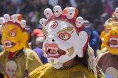 Tibetan Buddhist lamas in the mystical masks perform a ritual Tsam dance . Hemis monastery, Ladakh, India — Stock Photo