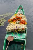Boat with flowers on lake — Stock Photo