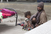 Indian beggar man with children on the street in Leh, Ladakh. India — Stock Photo