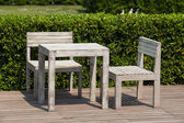 White wooden table and chairs outdoors — Stock Photo