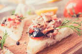 Tapas, pintxos with vegetables and fish — Stock Photo