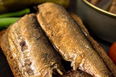 Tapas with a large smoked sardines — Stock Photo