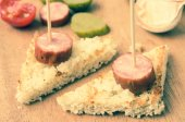 Pintxos snacks with smoked sausage — Stock Photo