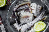 Alaska pollock raw cut into pieces for cooking — Stock Photo