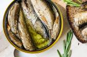 Can with smoked sardines top view — Stock Photo