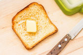 Fried slice of toast with butter — Stock Photo