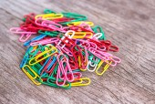 Colorful clips on wood background — Stock Photo