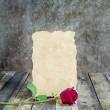 Fresh red rose and old paper on wooden background — Stock Photo #64717235