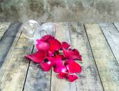 Fresh red rose in glass on wooden background — Stock Photo
