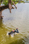 Myanmar children were playing by jumping from the tree at the river near U Bein Bridge — Foto Stock
