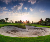 Sunset on golf field — Stock Photo
