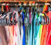 Clothes hang on a shelf — Stock Photo