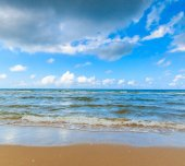 Sea sand beach in sunny day — Stock Photo