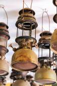 Lit hurricane lamps and lanterns — Stock Photo