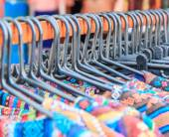 Fashion clothing on hangers — Stock Photo