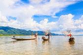Fishermen catches fish — Stock Photo