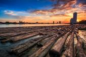 Sunset landscape at Pile of wood — Stock Photo