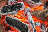 Burning charcoal in stove — Stock Photo