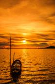 Sunset at sea and boat — Stock Photo