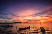 Sunset at sea and boats — Stock Photo