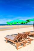 Sun loungers on beach — Stock Photo