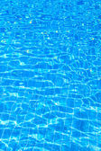 Water background in swimming pool — Stock Photo