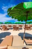 Sun loungers and  beach umbrellas — Stock Photo