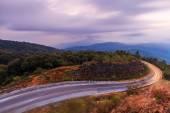 Empty asphalt road at sunrise — Stok fotoğraf