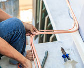 Worker  installing air conditioner. — Stock Photo