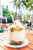 Coconut water at cafe — Stock Photo